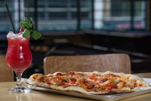 commercial image of pizza and cocktail.