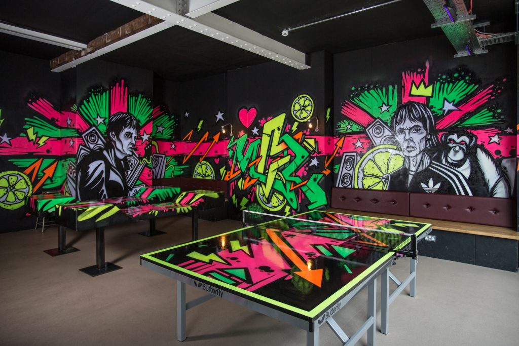 commercial photograph of UV ping pong tables