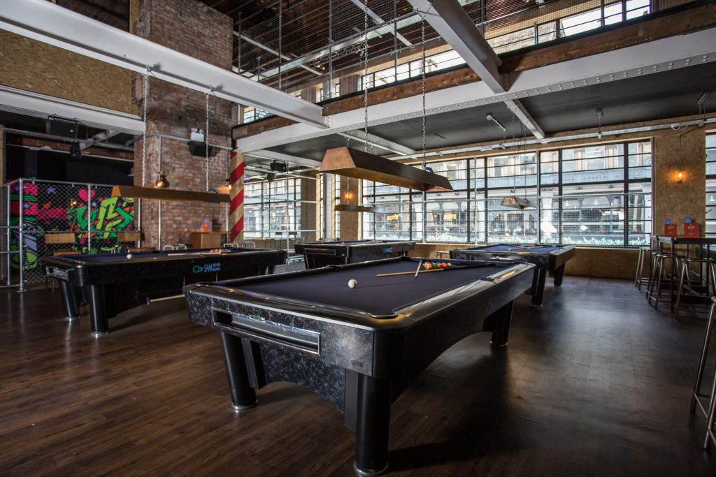 commercial image of pool tables.