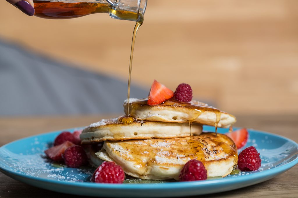 food photography pancakes syrup drizzle and fruit