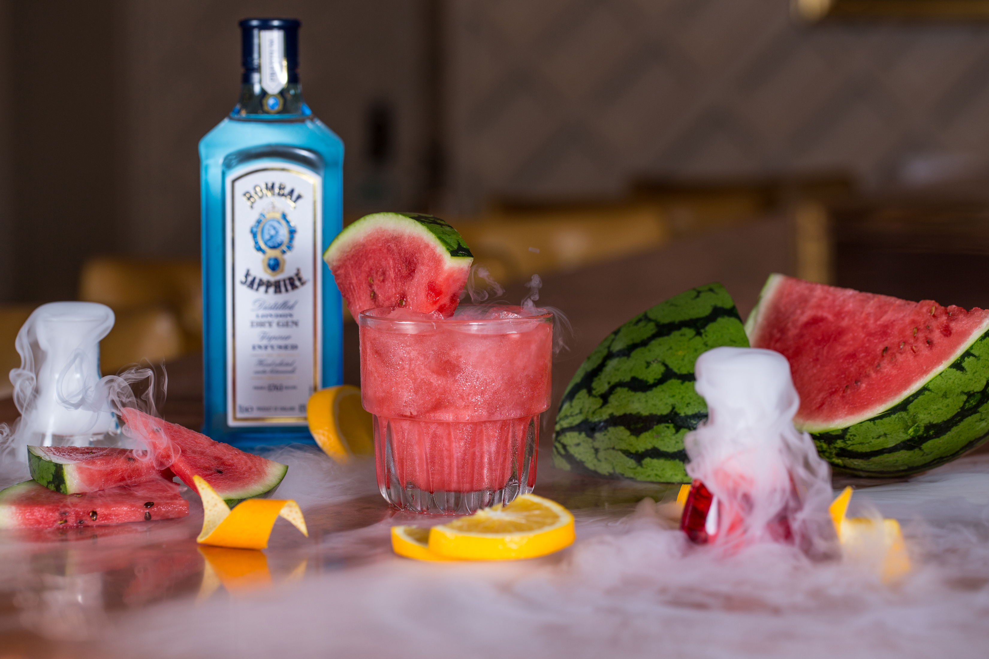 cocktail photograph with bombay sapphire gin, watermelon and dry ice.